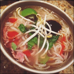 homemade sliced beef noodle soup pho lime cilantro bean sprouts sriracha hoison