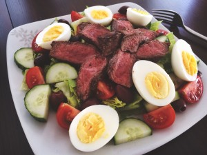 Fresh salad with hard boiled eggs, farmers market produce, and juicy seared steak, and a homemade vinaigrette