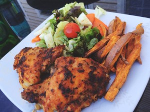 Crispy baked chicken thighs with homemade sweet potato fries and a side salad for dinner